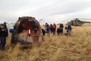 A rescue team operates near the Russian Soyuz capsule (via Roscosmos Space Agency AP)