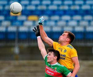 Mayo's Cilian O'Connor and Rosecomon's Enda Smith hit the ball. Photo: Sports file