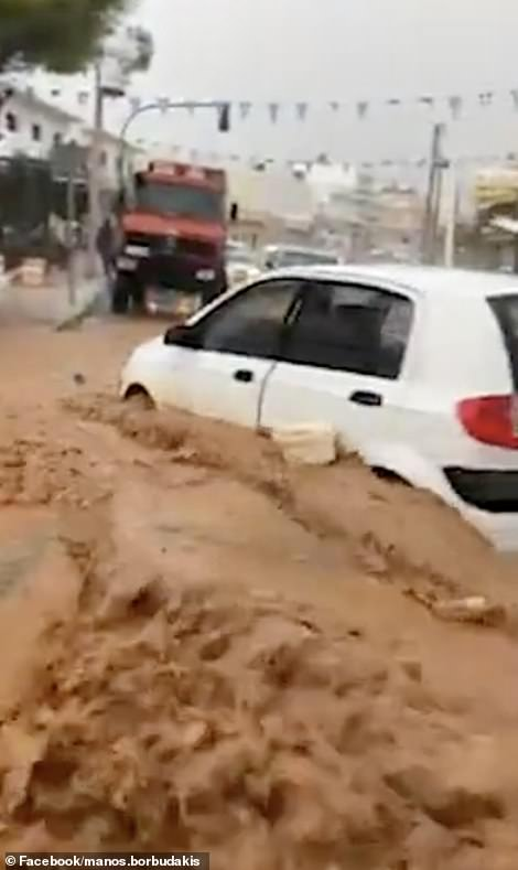 In the northern city of Hersonissos, a popular summer tourist resort, the floodwaters flooded homes and stores, and cars swept across the island.