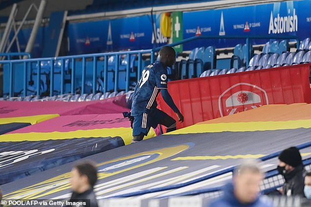 Pepe cut a lone figure as he moved up the empty stands on Elland Road.