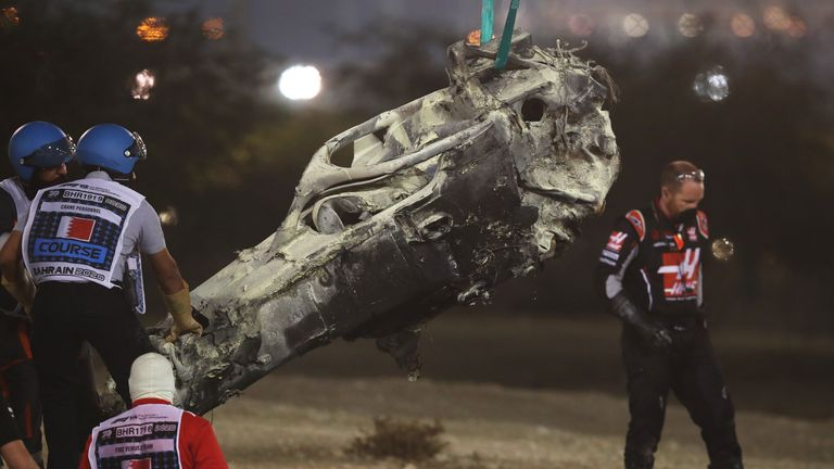 The wreckage of the car of Romain Grosjean, the French driver of the Haas F1, was removed during the Bahrain Formula One Grand Prix on November 29, 2020 at the Bahrain International Circuit in the city of Zakir.  (Photo by Hamad I MOHAMMED / Pool / AFP) (Photo by HAMAD I MOHAMMED / POOL / AFP via Getty Images)
