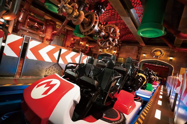 View of life-sized Mario karts for a ride at the new Nintendo theme park