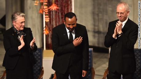 Abi Ahmed of Ethiopia seeks peace on the African horn while receiving the Nobel Peace Prize medal.