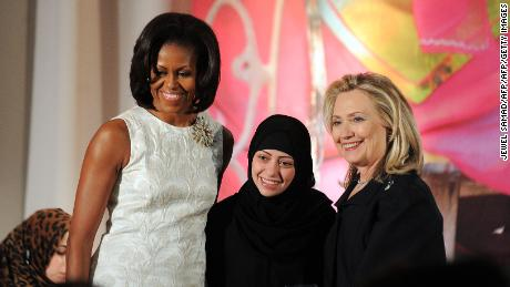Samar Badawi, leftist and then-US Secretary of State Hillary Clinton, who received the 2012 International Woman of Courage Award during a ceremony with then - US First Lady Michelle Obama.