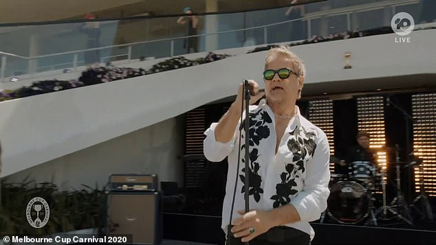 Pre-Race Entertainment: John Stevens performed the classic INX song Never Tear Us Asser emotionally at the Melbourne Cup on Tuesday afternoon.