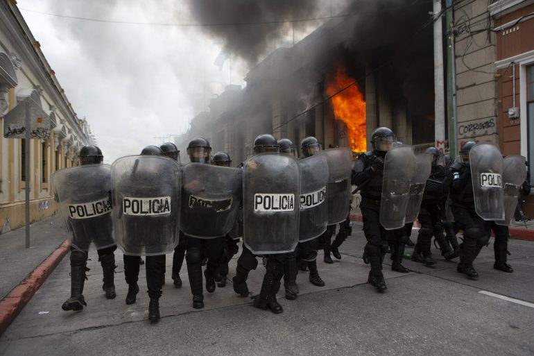 Protesters set fire to part of a Congress building in Guatemala