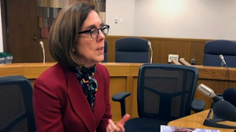 The Oregon governor tells employees to call police for people violating COVID regulations