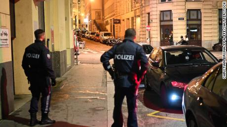 Police respond to a shooting near the main synagogue in Vienna.