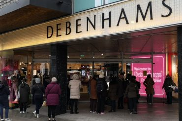 Shoppers queue outside Debenhams as it reopens after England's lockdown - a day after it revealed it was winding down 2/12/2020