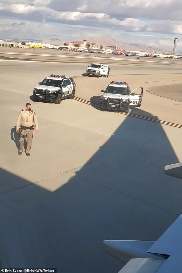 He moved to the vertical wing of the plane as police officers approached him
