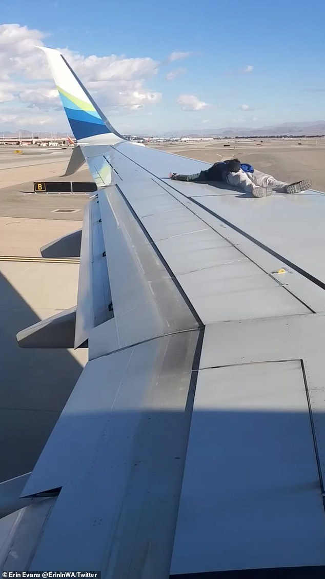 At one point, he even decided to lie on the wing of a sitting plane