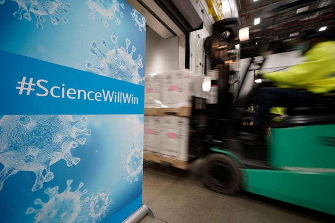 Boxes containing the Fischer-Bayonetech Kovid-19 vaccine will be loaded on a truck on Sunday for shipping at the Pfizer Global Supply Manufacturing Plant in Mitch Portage.