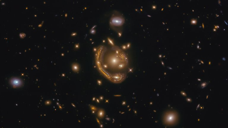 """The Hubble Space Telescope captures the largest and most complete """"Einstein rings"""" ever seen"""