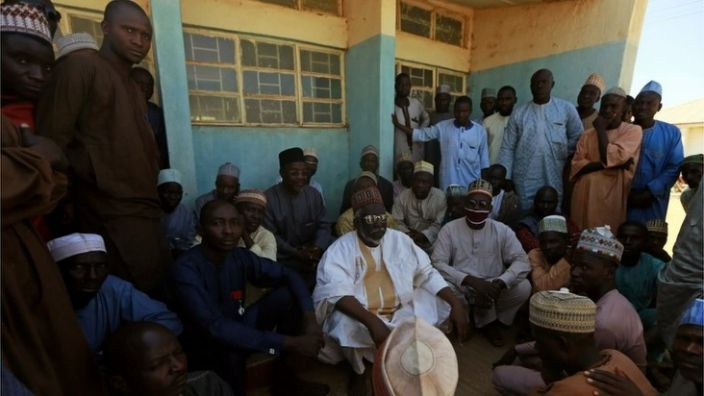 Parents gather at a government science school in Kankara, northwestern Katsina, Nigeria, on December 13, 2020, after gunmen abducted students.