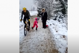 In Belgium, a cyclist creates a video provocation of a little girl being pushed