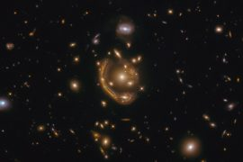 "One of the largest and most complete Einstein rings ever.  Astronomers call this the ""molten circle"""