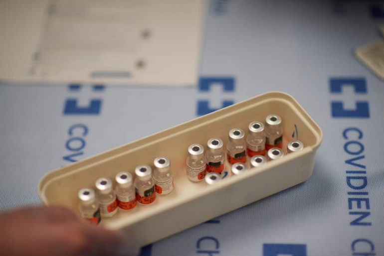 The FDA is investigating rare allergic reactions to the Pfizer corona virus vaccine, but says the rollout will continue.