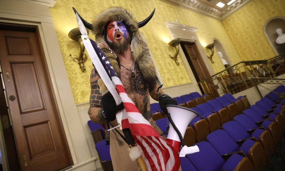One protester is known for staging demonstrations outside the Capitol, in which he cries out about various conspiracy theories, many of which are related to the beliefs propagated by QAnon.  Photo: WIN MCNAMEE / AFP