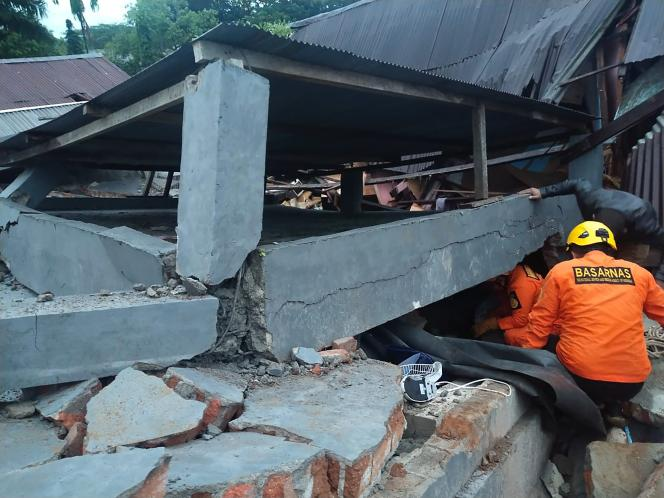 January 15 for survivors of a collapsed building in Mamuju, on the Indonesian island of Celeb.
