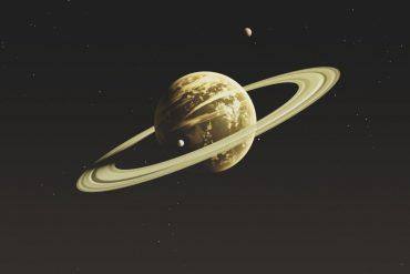 Saturn leans into the hands of its moons