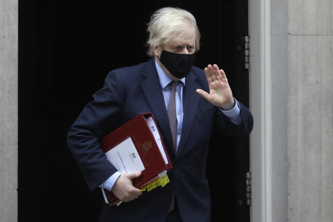 British Prime Minister Boris Johnson arrives in London on March 3.