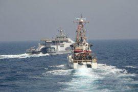 US Navy warning shots on Iranian ships in the Gulf