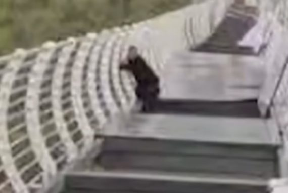Video: A glass bridge collapses and a man is trapped 100 meters high