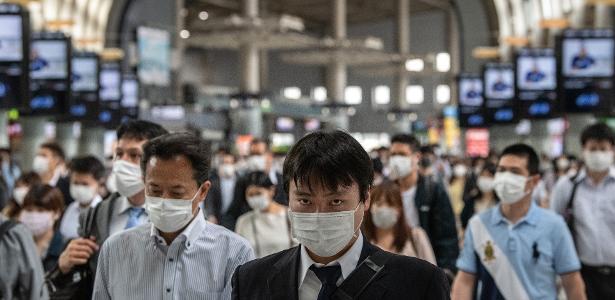 Japan extends virus emergency to 3 municipalities