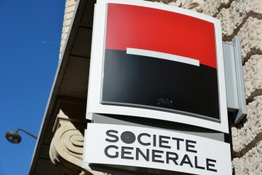 Two French men have been charged with hacking into the bank account of a Congolese minister