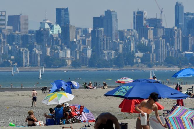 Canadians who want to escape the heat waves are coming to cool off on June 27, 2021 on a beach in Vancouver, British Columbia.