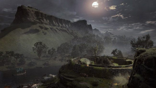 The flat top mountain rises into the night sky and can be seen in front of the circular fort.