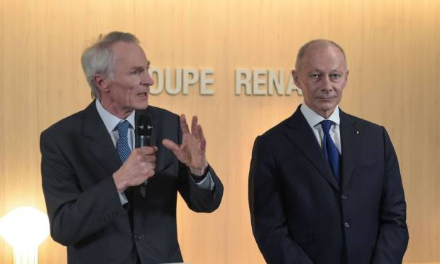 Renault's new chairman Jean-Dominique Senard speaks with Thierry Bollor, the company's new managing director.  Both replaced Carlos Ghose Photo: ERIC PIERMONT / AFP
