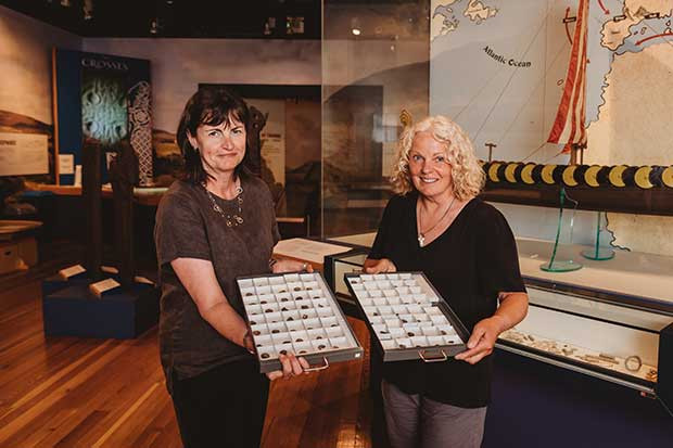 Allison Fox, curator of the Monks Museum, and Cath Giles, an amateur treasure hunter, present Viking-era fragments found on the Isle of Man.  © Monks National Heritage