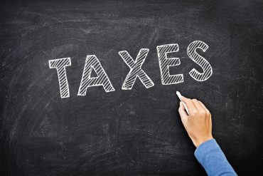 Global taxation of large corporations: unfair and counterproductive