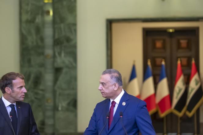 Emmanuel Macron with Iraqi Prime Minister Mustafa Al Qasimi in Baghdad, Iraq, August 28, 2021.n
