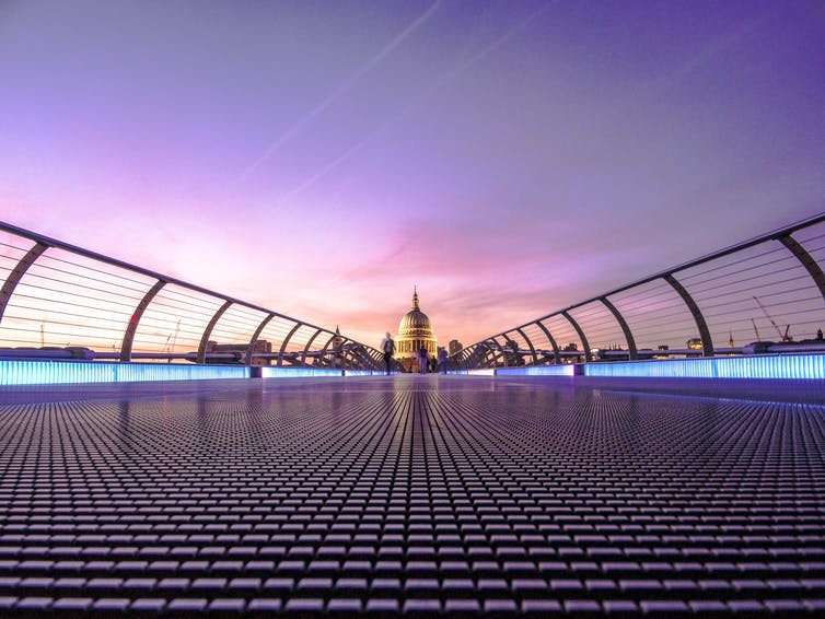 View of the Millennium Bridge in London in the evening