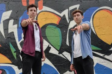 """The twins recreated Beagis 'dance """"Stein' Alive"""" in the middle of the street."""