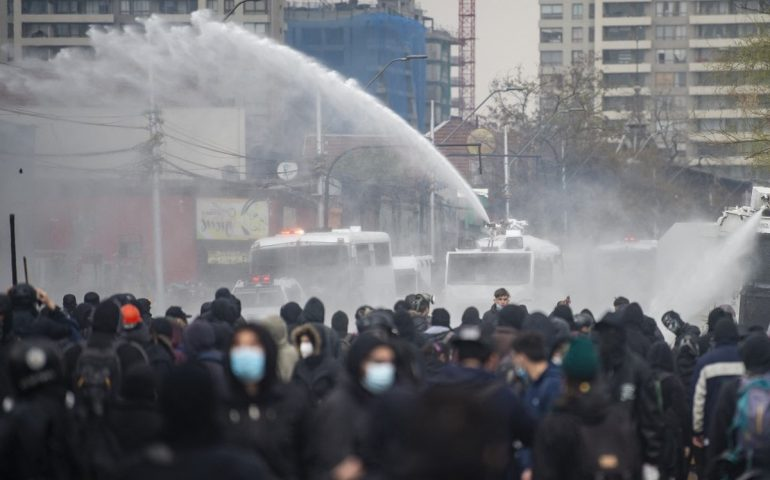 Police in riot gear storm a rally in Chile on Friday, marking the 48th anniversary of the coup.