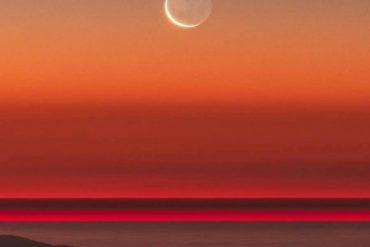 นักวิทยาศาสตร์ใช้การวัดแสงของดิน ซึ่งเป็นแสงจางๆ บนส่วนที่มืดของดวงจันทร์เสี้ยว บวกกับการวัดด้วยดาวเทียมเพื่อเรียนรู้ว่าโลกกำลังหรี่แสงอยู่ เหตุผลก็คือมีเมฆที่สว่างน้อยลงเนื่องจากอุณหภูมิที่ร้อนขึ้น (Photo by Yuri Beletsky)