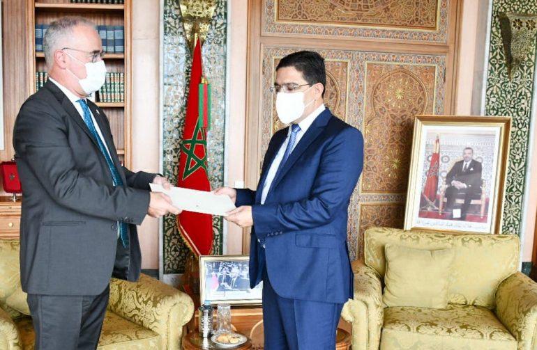 The new Ambassador of Ireland presents Burita with copies of his credentials
